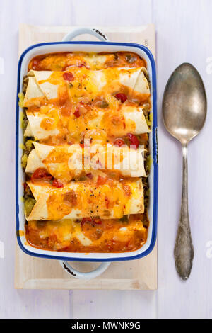 Beef enchiladas with tomato sauce and cheese - Stock Photo