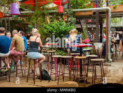 The garden of Szimpla Kert , one of the oldest Ruin Pubs In Budapest - Stock Photo