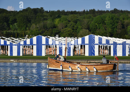 Boat tents erected on the bank of the River Thames in preparation for Henley Royal Regatta, Oxfordshire, UK - Stock Photo
