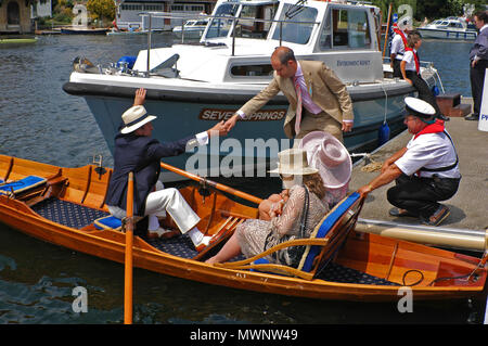 Spectators in a rowing boat, Henley Royal Regatta, Oxfordshire, UK - Stock Photo