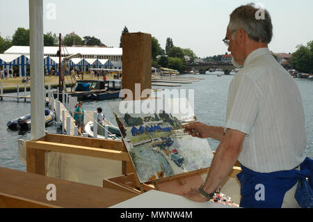 Artist in residence paints a regatta scene, Henley Royal Regatta, Oxfordshire, UK - Stock Photo