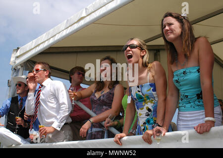 Spectators cheering the rowers on, Henley Royal Regatta, Oxfordshire, UK - Stock Photo