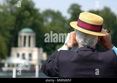 A spectator near Temple Island, Henley Royal Regatta, Oxfordshire, UK - Stock Photo