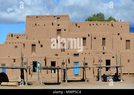 Taos Pueblo, indigenous architecture north of Red Willow Creek, overall view of the multiple stacked adobe dwellings, near Taos, NM, USA - Stock Photo