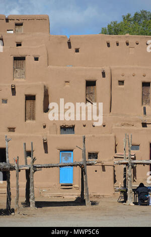 Taos Pueblo, indigenous architecture north of Red Willow Creek, close-up of the multiple stacked adobe dwellings, near Taos, NM, USA - Stock Photo