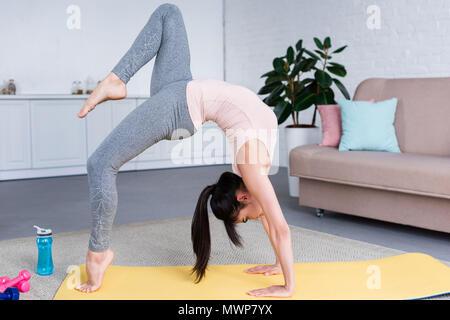 beautiful woman exercising eka pada rajakapotasana  one