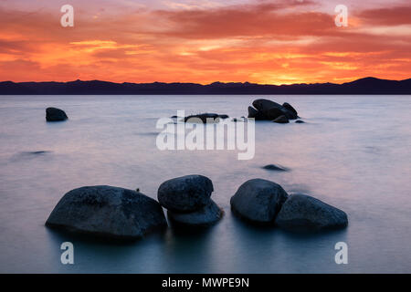 Lake Tahoe sunset at the famous Whale Beach near Incline Village, Nev., USA. - Stock Photo
