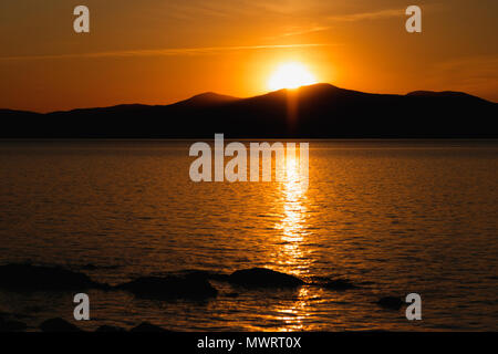 Sunset on Saint Lawrence River, Quebec, Canada. Canadian landscape at Sunset in the region Bas Saint Laurent. Mountains and river - Stock Photo