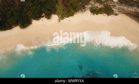 Tropical beach among rocky cliffs. Karang Dawa, Manta Bay or Kelingking Beach on Nusa Penida Island, Bali, Indonesia. Travel concept. - Stock Photo