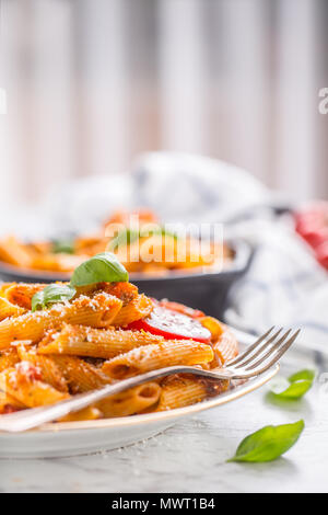 Italian food and pasta pene with bolognese sause on plate. - Stock Photo