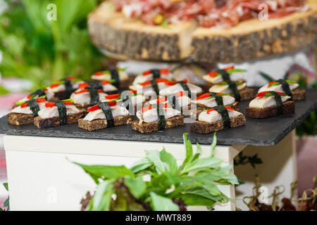 Beautifully decorated catering banquet table with different food - Stock Photo