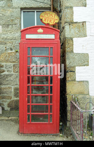 Red Telephone Box and Post Office Sign, Mousehole, Cornwall UK - Stock Photo