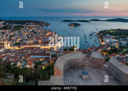 Elevated view over Hvar Town from the Spanish Fortress at dusk, Hvar, Croatia, Europe - Stock Photo