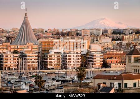The city of Siracusa with Mount Etna on the background, Sicily, Italy - Stock Photo