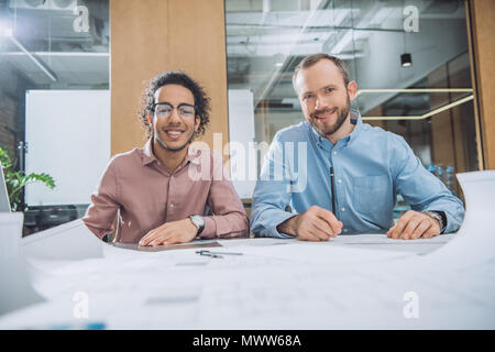 architects working on project together at modern office - Stock Photo