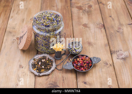 Assorted dried flowers and tea on a wooden background. Natural health. Aromatherapy. Free space for text. Copy space. - Stock Photo
