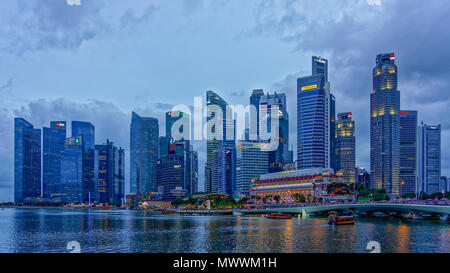 Central Business District with fullerton hotel and fullerton One during blue Hour - Stock Photo