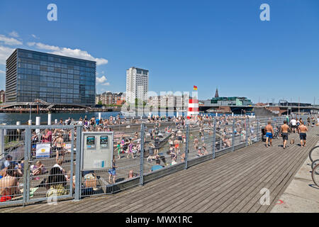 Copenhagen, Denmark. 2nd June, 2018. On the second day of the harbour bath season that began yesterday thousands of Copenhageners, tourists and visitors enjoy another warm and sunny summer day of the long-lasting and early heat wave that made May the sunniest and warmest on record in Denmark, here in the Islands Brygge Harbour Bath in the inner harbour. In Denmark a summer day is any day on which temperatures top 25 degrees Celsius - until now there have been 19 of these - actually, on many days temperatures have been close to 30 degrees. Credit: Niels Quist / Alamy Live News. - Stock Photo