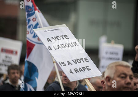 Manchester, Greater Manchester, UK. 2nd June, 2018. A banner at The Democratic Football Lads Association march in Manchester two weeks after the anniversary of the Manchester Bomb. The March was met by a counter demonstration by organised by Stand Up to Racism. Credit: Steven Speed/SOPA Images/ZUMA Wire/Alamy Live News - Stock Photo