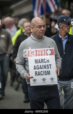 Manchester, Greater Manchester, UK. 2nd June, 2018. A member of The Democratic Football Lads Association march in Manchester two weeks after the anniversary of the Manchester Bomb. The March was met by a counter demonstration by organised by Stand Up to Racism. Credit: Steven Speed/SOPA Images/ZUMA Wire/Alamy Live News - Stock Photo