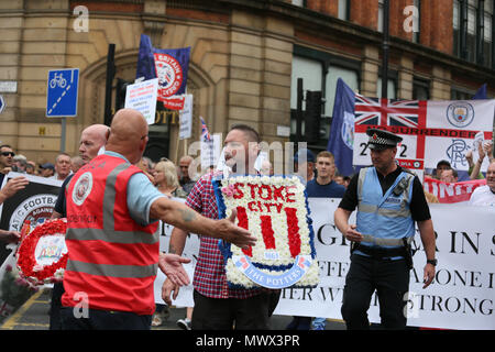 Manchester, UK. 2nd June 2018. A supporter of the right wing Democratic Football lads Alliance carrying a wreath or flowers with stoke city written on it, Manchester, 2nd June, 2018 (C)Barbara Cook/Alamy Live News - Stock Photo
