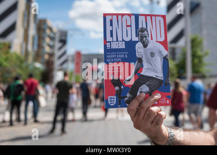 London, UK.  2 June 2018. A match programme on sale for the friendly football match between England and Nigeria at Wembley Stadium.  This is the final match at Wembley before England travel to the World Cup in Russia.   Credit: Stephen Chung / Alamy Live News - Stock Photo