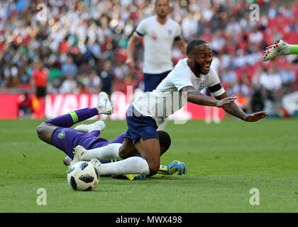 London, UK. Wembley Stadium, London, UK. 2nd June, 2018. International football friendly, England versus Nigeria; Raheem Sterling of England taking a dive in the penalty area over Goalkeeper Francis Uzoho of Nigeria and received a yellow card for his efforts Credit: Action Plus Sports/Alamy Live News Credit: Action Plus Sports Images/Alamy Live News - Stock Photo