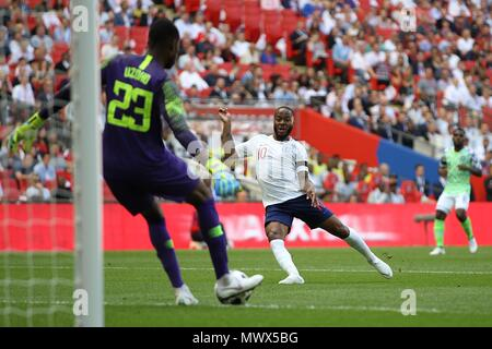 London, UK. 2nd June 2018. London, UK. 2nd June 2018.London, UK. 2nd June 2018. Francis Uzoho of Nigeria clears under pressure from Raheem Sterling of England during the International Friendly match between England and Nigeria at Wembley Stadium on June 2nd 2018 in London, England. (Photo by Matt Bradshaw/phcimages.com) Credit: PHC Images/Alamy Live News - Stock Photo