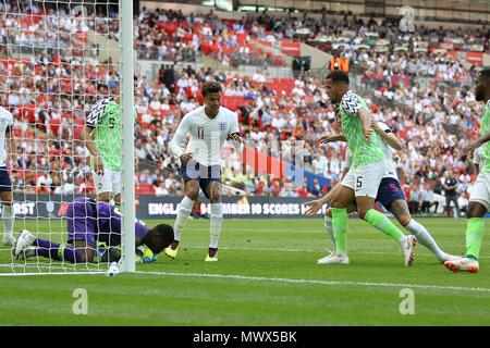 London, UK. 2nd June 2018. London, UK. 2nd June 2018.London, UK. 2nd June 2018. Francis Uzoho of Nigeria saves at the feet of Dele Alli of England during the International Friendly match between England and Nigeria at Wembley Stadium on June 2nd 2018 in London, England. (Photo by Matt Bradshaw/phcimages.com) Credit: PHC Images/Alamy Live News - Stock Photo