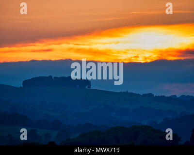 Hazleton Clump Cairn, Ashbourne. 2nd Jun, 2018. UK Weather: spectacular sunset over the ancient woods Hazleton Clump Cairn near Thorpe taken from Ashbourne Derbyshire, Peak District National Park Credit: Doug Blane/Alamy Live News - Stock Photo