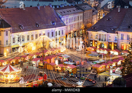 Christmas market in Plaza Piata Mare, Sibiu, Romania, Europe - Stock Photo