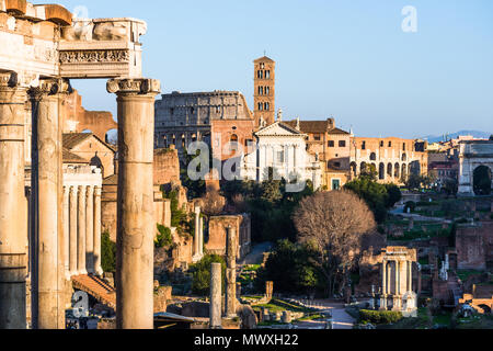 Ancient Roman cityscape at Roman Forum with Basilica of Maxentius and the Coloseum, UNESCO World Heritage Site, Rome, Lazio, Italy, Europe - Stock Photo