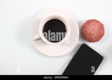 Top view, Espresso coffee in white cup with homemade brownie muffin cakes and smartphone isolated on white background, Coffee break in concept in soft - Stock Photo