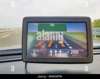 Travel concept with GPS, navigation inside a car on road in natural background, (Global Positioning System) - Stock Photo