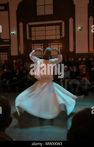 whirling dervishes dancing in traditional turkish dervish costume in istanbul - Stock Photo