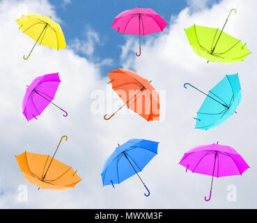 Colorful and beautiful umbrellas in blue sky background, Street decoration. - Stock Photo