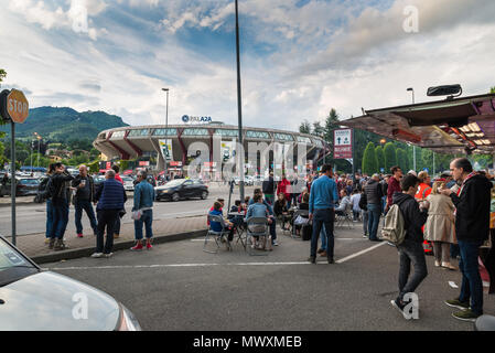 Varese, Italy - May 16, 2018: Area in front of the sports hall, Pala2a, before a match, fans and street vendors. Palace of Varese Basketball - Stock Photo