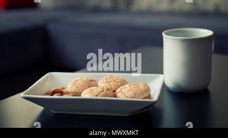 Almond Cookies And A Cup Of Coffee - Stock Photo