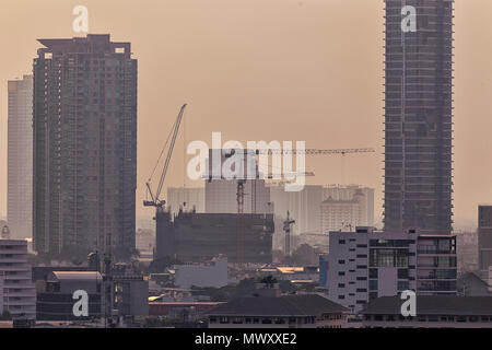 High rise tower buildings under construction in Bangkok, Thailand - Stock Photo
