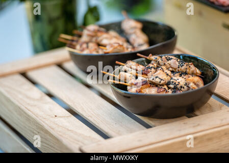 Marinated pink red raw beef meat kebabs on wooden sticks - Stock Photo