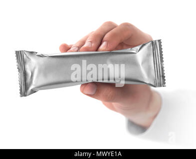 aluminum packaging in hand - Stock Photo
