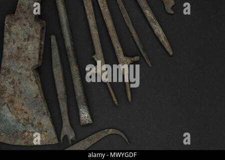 Very old and rusty tools on black background with free space - Stock Photo
