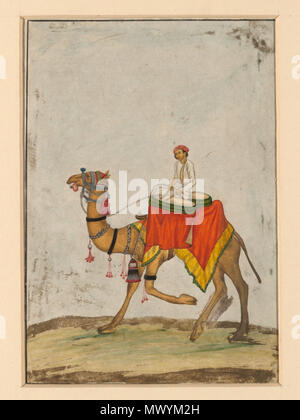 .  English: One of six figures from the Mughal emperor's ceremonial procession on the occasion of the Id. . circa 1840(painted). Khan, Mazhar Ali (possibly, Artist) 19 A camel with its rider playing kettle drums. - Stock Photo