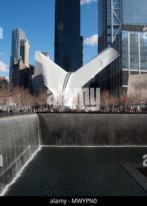 National September 11 Memorial North Pool with the Oculus in background - Stock Photo