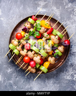 Raw diet kebab from fresh vegetables on skewers. Vegetables for grilling.American cuisine.