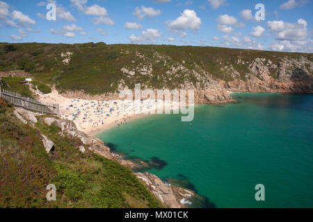 Beach at Pothcurno Bay / Cove in Cornwall, England, UK, showing the beach on a summer day. Aerial shot of holidaymakers sunbathing and swimming. - Stock Photo