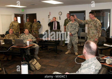 Maj. Gen. Jefferson Burton, the adjutant general of the Utah Army National Guard, visits with Soldiers, airmen and civilians who are training during the Cyber Shield 17 exercise today.  Cyber Shield is a National Guard exercise in collaboration with the U.S. Army Reserve designed to assess Soldiers, airmen and civilian personnel on response plans to cyber incidents taking place April 24 to May 5, 2017 at Camp Williams, Utah. (Wisconsin Army National Guard : Staff Sgt. Matthew Ard) - Stock Photo