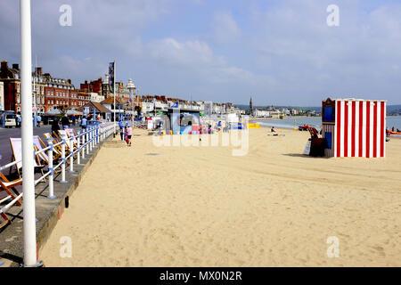 Weymouth, Dorset, UK. May 18, 2018.  Holidaymakers enjoying the beach and promenade on a May morning at Weymouth in Dorset,UK. - Stock Photo