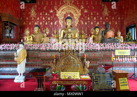 Altar Buddhist temple Wat Duang Dee Chiang Mai Northern Thailand - Stock Photo