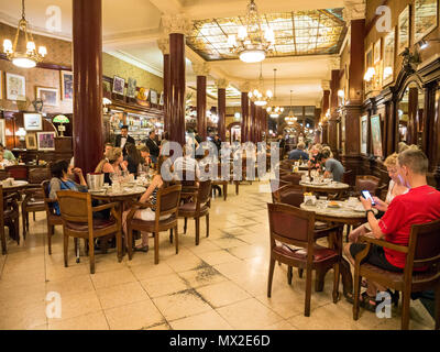 People in cafe Tortoni on Avenida de Mayo in city centre Microcentro in Monserrat district in capital Buenos Aires, Argentina - Stock Photo